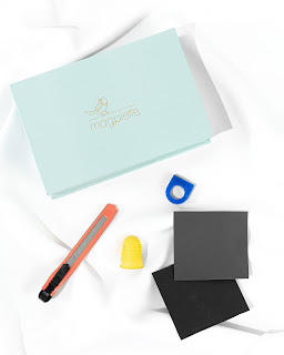 The Magpiette Ring Carving Kit with all the tools needed to design and carve a ring from wax to be cast into solid sterling silver. The contents shown include a craft knife, sandpaper, thumb protector and wax blank