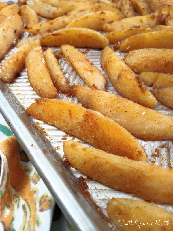 Perfect Roasted Potato Wedges! A fool-proof recipe for baked potato wedges that are crispy and crackly on the outside with fluffy, flavor-packed insides and the cooking technique that gets you both!