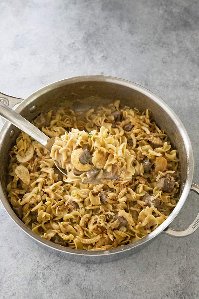 Creamy French Onion Beef and Noodles is a creamy, easy, and delicious one pot dinner!  Your family will love this savory combo of tender beef and egg noodles!