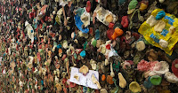 Alley wall covered with various color wads of bubble gum