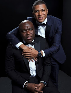 Wilfried Mbappe posing for picture with his son Kylian Mbappe