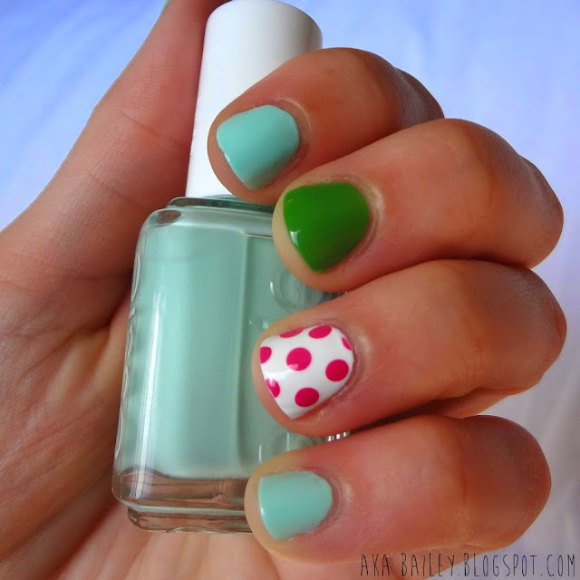 Mint nails with green and pink polka dot accents