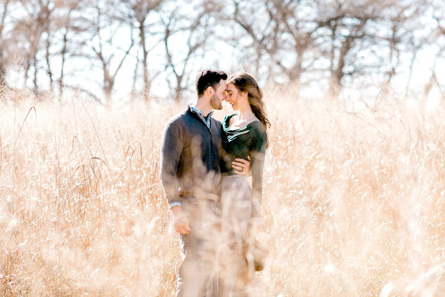 engagement photo in tall grass field