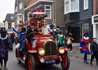 Sinterklaas parading through town on an antique fire engine, Zaandam, The Netherlands