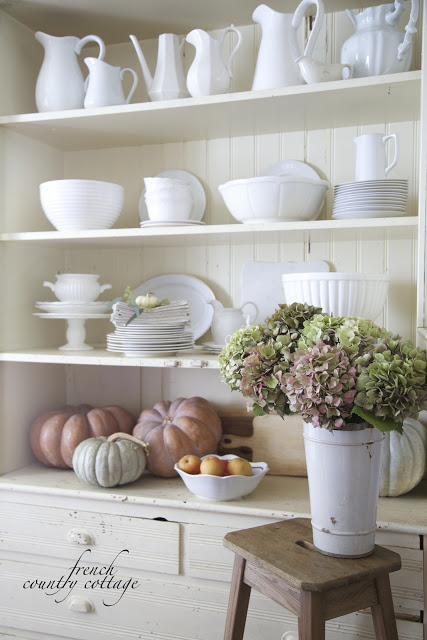 autumn display with white dishes