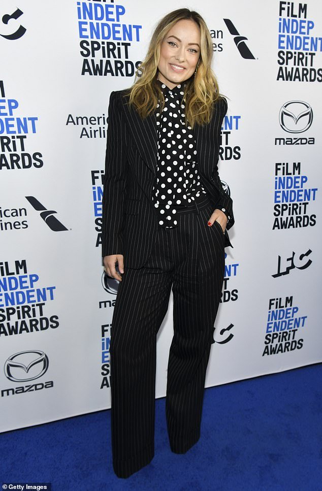 Olivia Wilde makes a statement in black pinstripe suit and polkadot shirt at the FI Spirit Awards Brunch