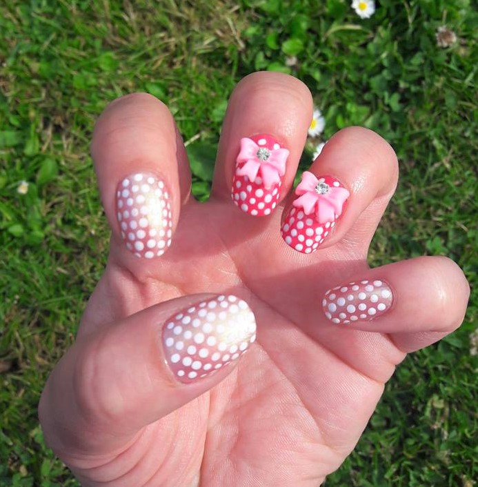 Cute 3D pink bow charm nails from Charlie\'s nail art.