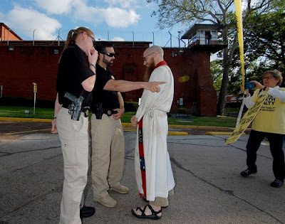 Jeff Hood, a Denton Texas based pastor, faces arrest after crossing security-tape line, Tuesday evening, March 22, 2016, Huntsville Texas.