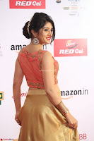 Harshika Ponnacha in orange blouuse brown skirt at Mirchi Music Awards South 2017 ~  Exclusive Celebrities Galleries 018.JPG