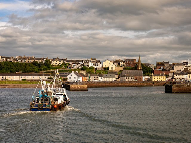 Photo of Alauna about to enter Maryport Harbour from the basin