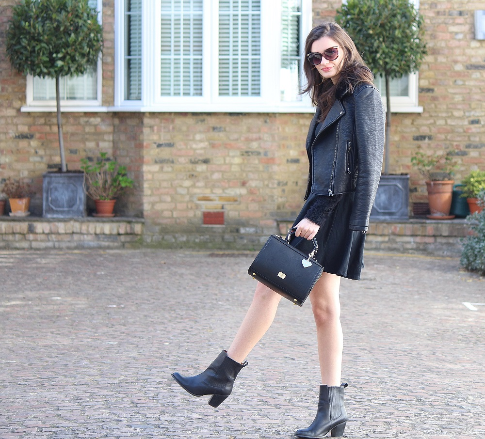 peexo fashion blogger wearing all black leather jacket and skater dress and ankle boots and box bag and sunglasses in spring