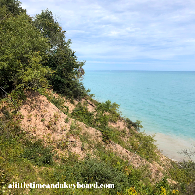 Undeveloped bluffs yield to the blues of Lake Michigan at Lion's Den Gorge Nature Preserve near Milwaukee, Wisconsin