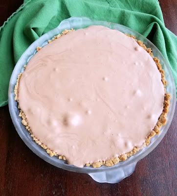 frozen chocolate pie waiting for whipped cream topping