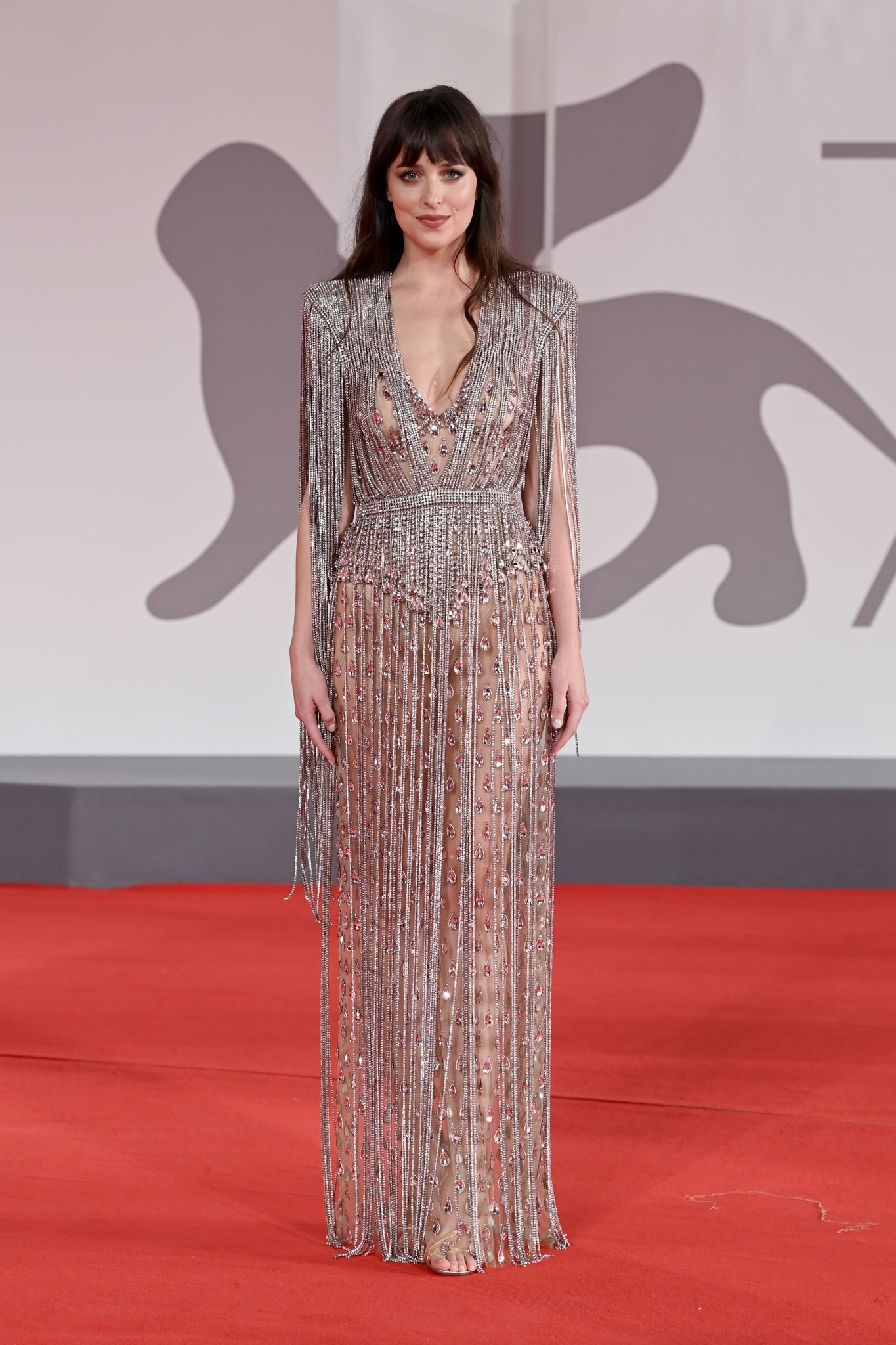 Dakota Johnson wowed in a sheer dress at her Venice Film Festival premiere