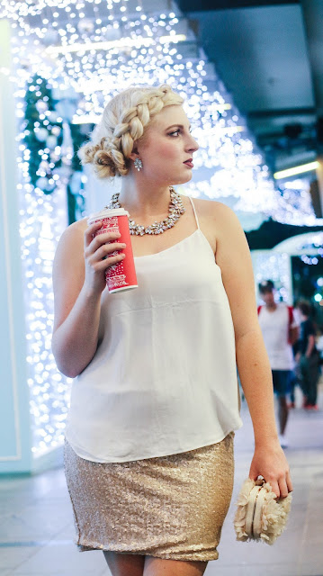 Fashion and Travel Blogger GlobalFashionGal (Brianna Degaston) with her french braid messy bun during the Christmas time at Orchard Road in Singapore.