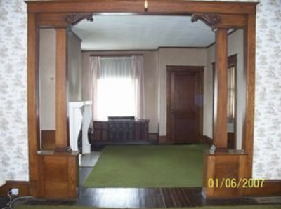 color photo of wood colonnade inside Sears No 137, 40 4th Street, Canisteo, New York