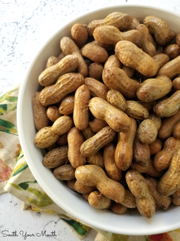 Classic Southern Boiled Peanuts! An easy to follow recipe for this favorite Southern snack that will quickly walk you through the differences in green and raw peanuts, seasoning variations and tips for cooking the perfect pot of boiled peanuts! #boiledpeanuts