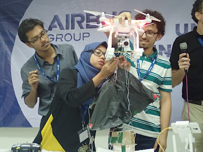 Team International Islamic University Malaysia explaining to the judges how their drone would work.
