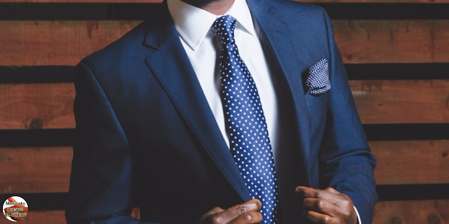 "Header image of the article: ""5 Keys To Changing Your Mindset For Success"". Successful man in a suit and tie."