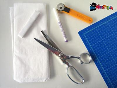 strumenti utili per il cucito: veltro a strisce, penna cancellabile,
