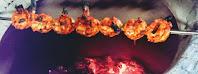 Cooking prawns over charcoal Tandoor for Tandoori prawns Recipe