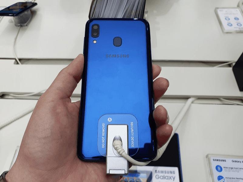 Dual-cam and fingerprint scanner behind