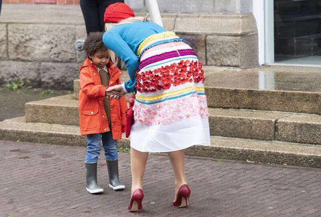 Queen Maxima wore a colourful midi skirt from Claes Iversen Haute Couture Spring Summer 2017 collection. Blue silk blouse