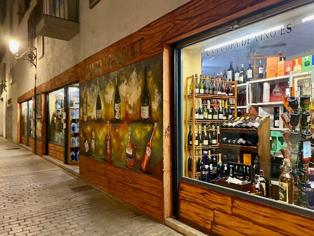 Street art on a wine shop in the old historic centre of Valencia, Spain