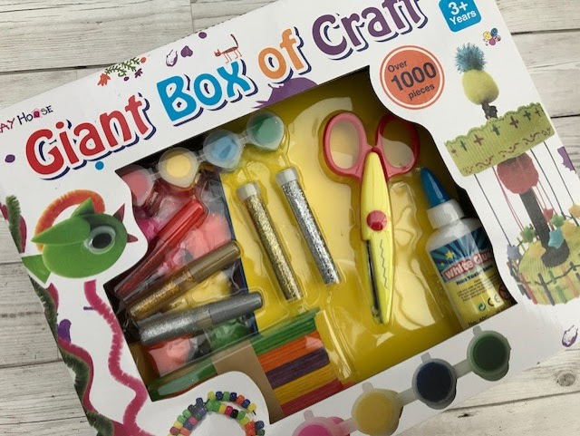 Front of the box filled with craft supplies