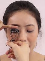 Give a lashes a good squeeze before putting on falsies.