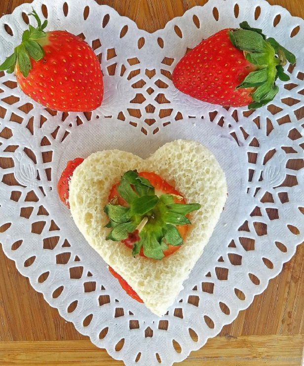 this is a heart shaped cutter on bread to make tea sandwiches with strawberries and cream cheese