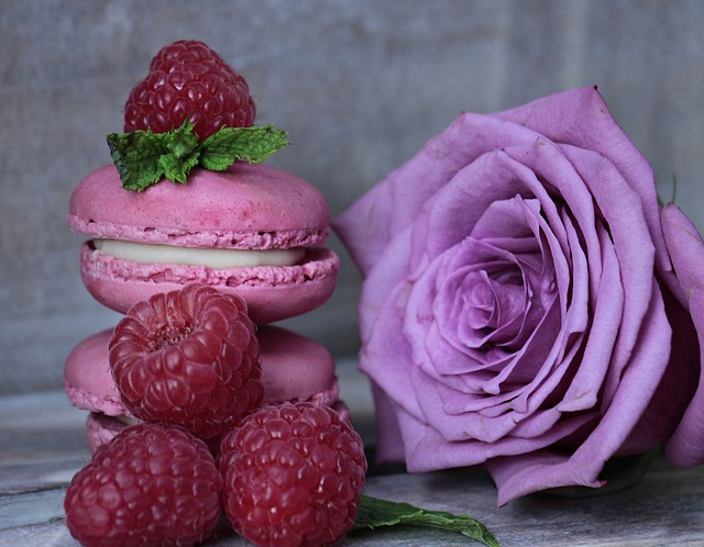 Purple rose flower bloom full petals lilac with raspberries and macaroons