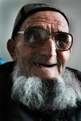 old man with beard and glasses
