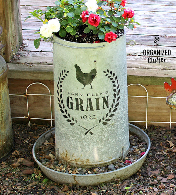 Photo of a chicken feeder stenciled with a farm blend grain stencil