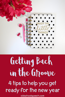 planner next to red flowers with pen and paperclip beside planner. Text on the planner: Enjoy the little things. Text under picture: Getting back in the groove. 4 tips to help you get ready for the new year.