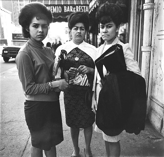 a Dianne Arbus photograph of three women interupted in the moment