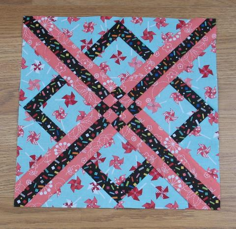 Hot Cross Quilt Block designed by Elaine Huff of Fabric406
