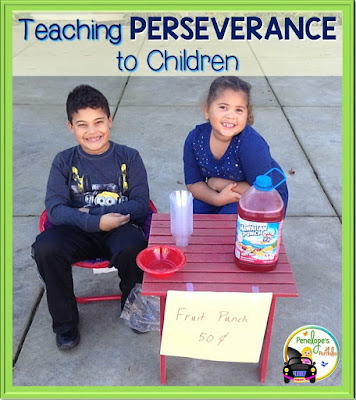 Two children showing perseverance with a homemade fruit punch stand