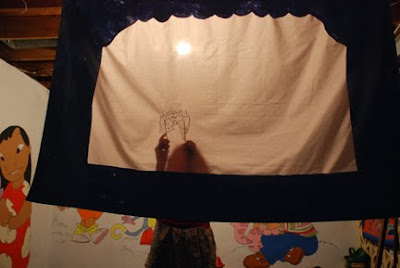 shadow puppet theater old sheet