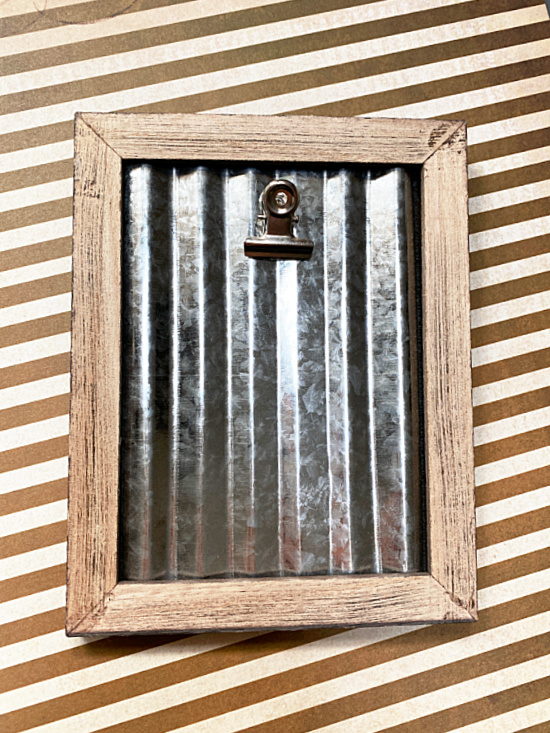 corrugated metal with a clip in a frame