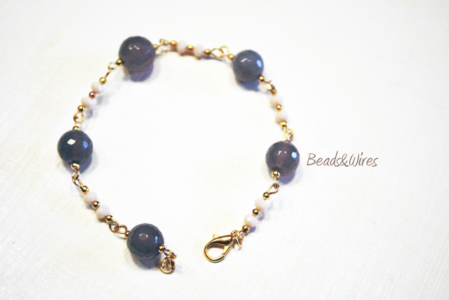 bracciale perle viola