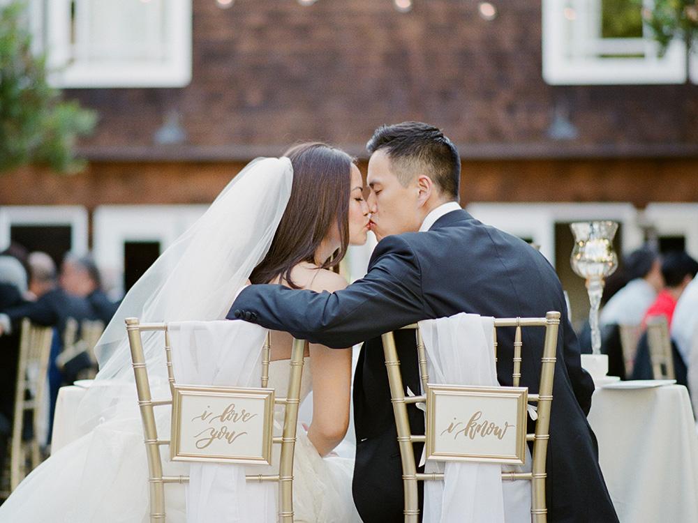 Bride and Groom kissing in Stanford Gardern Hotel
