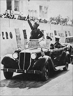 Mussolini would ride in an open-topped car, miking the applause of the crowds