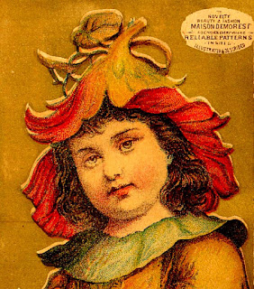 fanciful nasturtium of yellow & red serves as hat for girl