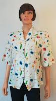 https://www.vinted.fr/femmes/blouses-manches-courtes/450995071-chemisier-80ies-taille-44-46-blanc-fleurs-colorees