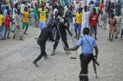 See Photos: Thug disrespects Government, grabs a police officer's gun in Maiduguri