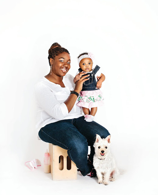 When Dogs Heal: One of the stunning images from this book featuring a black woman holding her baby and with her little dog sitting by her feet