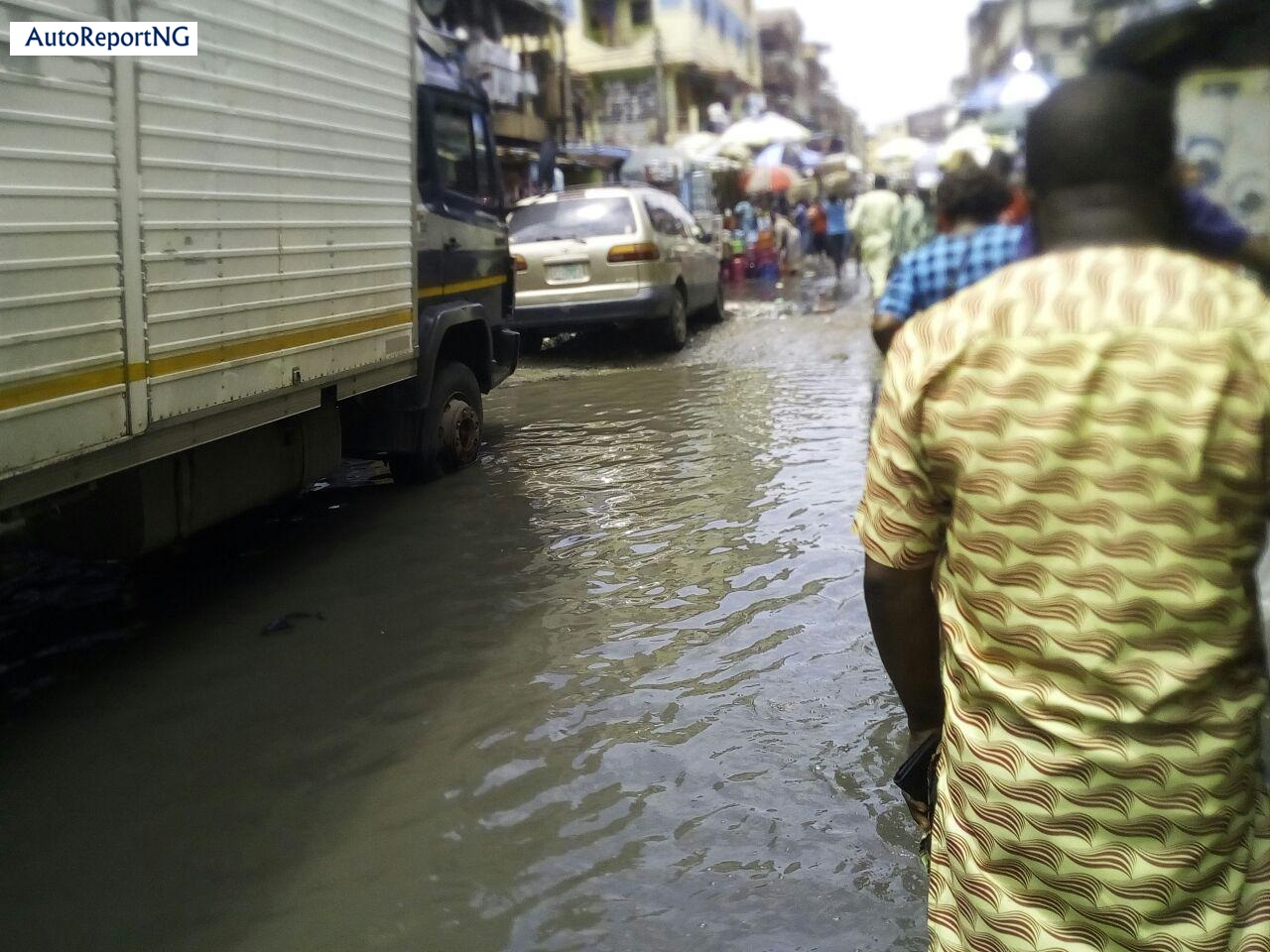 Flooded Jankara Market In Lagos Where Traders, Residents Wear Rain Boots To Work 5