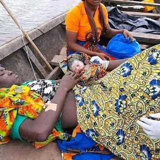 (Pics) Pregnant Woman give birth to child inside a cannoe while fishing in the middle of a river.