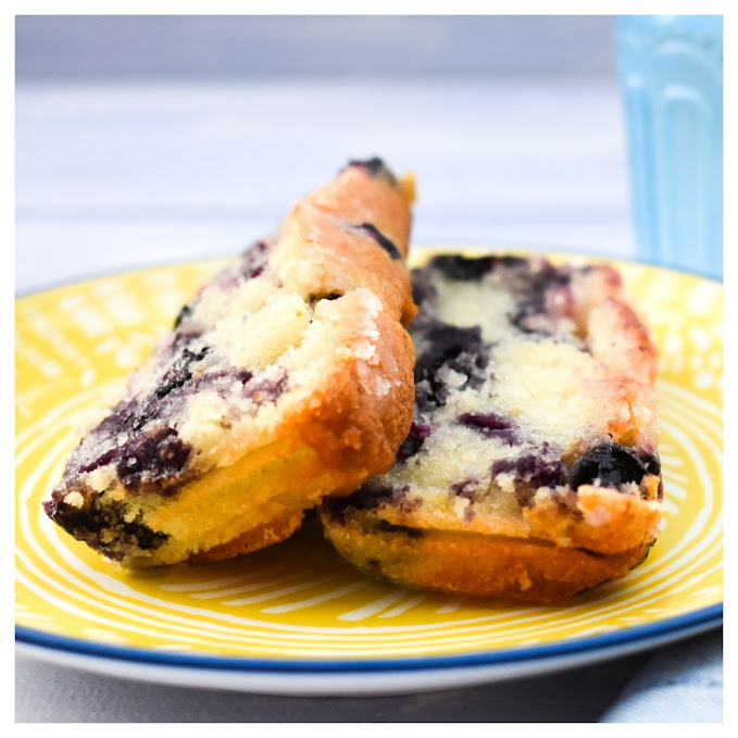 Slices of blueberry lemon cake on a yellow plate